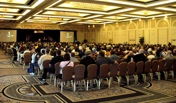 George Hrab on stage in front of 900+ members of the TAM 6 audience