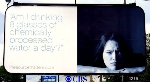 Billboard warns that chemically processed water causes furrowed brow syndrome.
